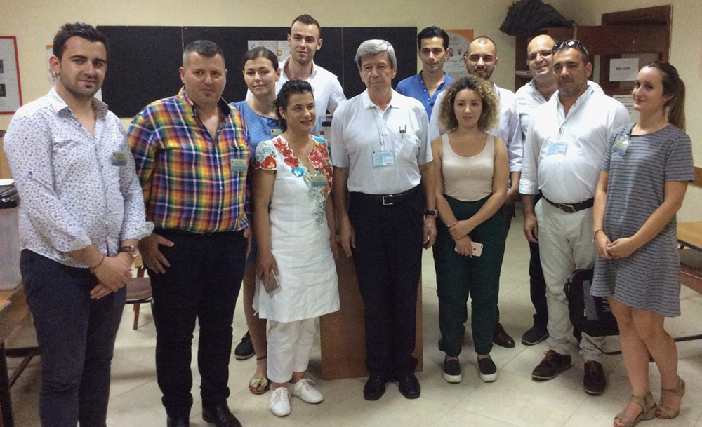 A dozen observers, incluing MEP Eduard Kukan, standing together in a polling place in Albania