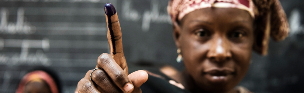 Woman in Mali showing her finger after having voted
