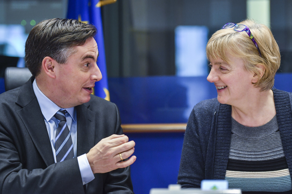 MEPs David McAllister and Linda McAvan talk to one another during a meeting the European Parliament